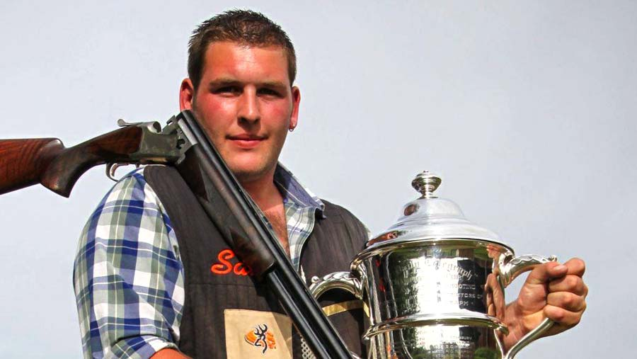 Sam Green, the best clay shooter, holding his prize.